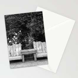 Wooden chairs and table in overgrown garden Stationery Cards
