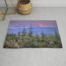 Sierra Nevada at sunset. Purple clouds Rug