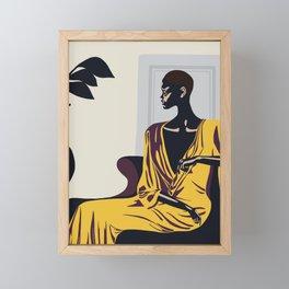 Yellow robe Framed Mini Art Print