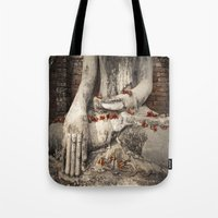 buddhism Tote Bags featuring Buddha with flowers by Maria Heyens