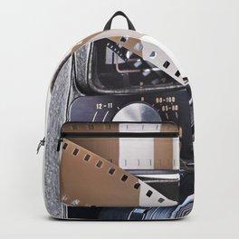 Retro mechanical movie camera and film Backpack