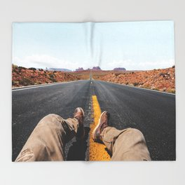 on the road in the monument valley Throw Blanket