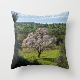 An almond tree in flower in the Algarve countryside Throw Pillow