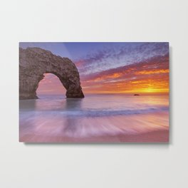 Durdle Door rock arch in Southern England at sunset Metal Print