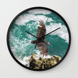 AERIAL PHOTOGRAPHY OF VULTURE FLYING ON TOP OF ROCK FORMATION BESIDE SEA AT DAYTIME Wall Clock