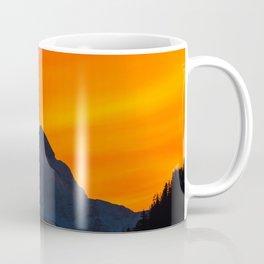 Stunning vibrant sunset behind mountain Coffee Mug