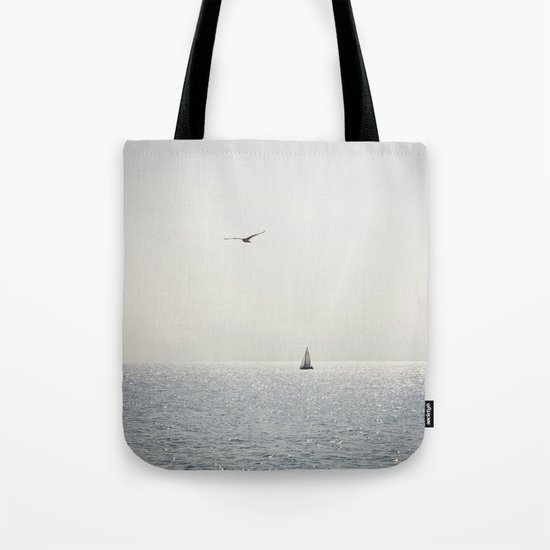 Fly over the sea Tote Bag
