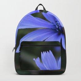 Macro shot of a dark blue blossom Backpack