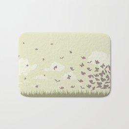 flying butterflies on a green landscape with sun Bath Mat