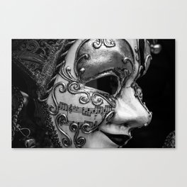 Close-up of a Venetian carnival mask with black and silver white ornaments Canvas Print