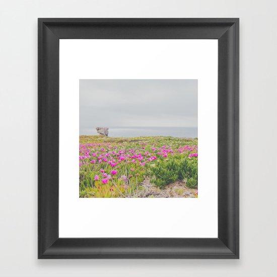 Across the flowers to the ocean Framed Art Print