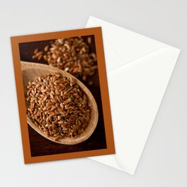 Brown flax seeds portion on wooden spoon Stationery Cards