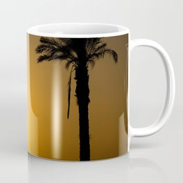 Golden Andalusian sunset with silhouette palm trees and mountain Coffee Mug