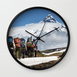 Group of hikers climbing on mountain on background volcanoes of Kamchatka Peninsula Wall Clock