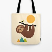 cartoons Tote Bags featuring Keep Calm And Live Slow by Andy Westface