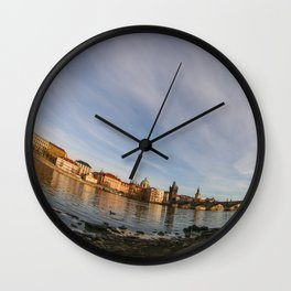 By the river in Prague (all askew) Wall Clock