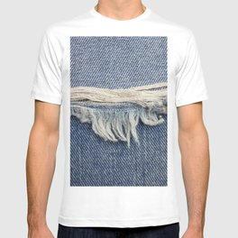 Textures ripped jeans background. T-shirt