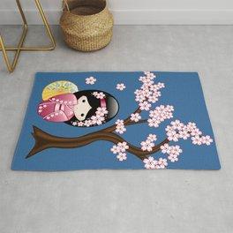 Japanese Spring Kokeshi Doll on Blue Rug