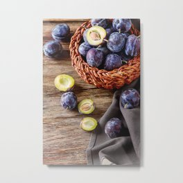 Ripe plums scattered on a brown wooden background. Bio healthy fruits.  Metal Print