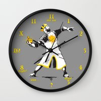 banksy Wall Clocks featuring Banksy Python 1-2-5 by kgullholmen