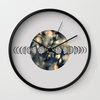 moon phases Wall Clocks featuring Moon Phases by amyrose
