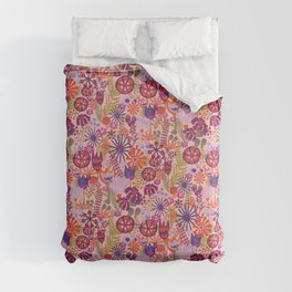 Doodle flowers. Tulips, dianthus, and lily flowers on a light pink background Comforters