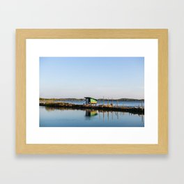 Hut by the river Framed Art Print