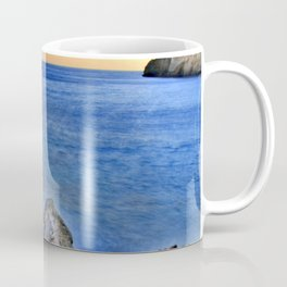 Beach at sunset with a rocks on the s Coffee Mug