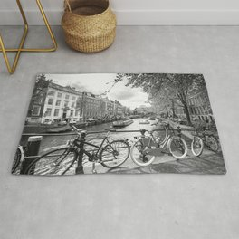 Bicycles parked on bridge over Amsterdam canal Rug