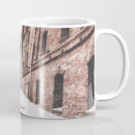 walkway in the middle of the brown brick buildings Coffee Mug