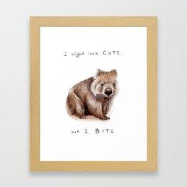 I might look cute, but I bite Framed Art Print