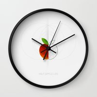 half life Wall Clocks featuring HALF (apple) LIFE by Nillustra™