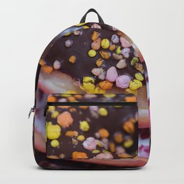 Macro shot of stack of donuts over pink background Backpack
