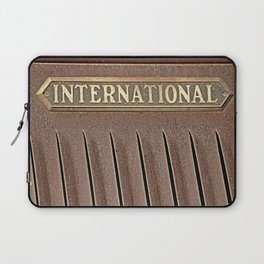 International emblem on an old truck rusting in a field Laptop Sleeve