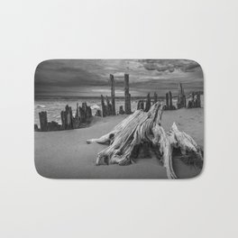 Tree Stump and Pilings on the Beach in Black and White at Kirk Park by Grand Haven Michigan Bath Mat
