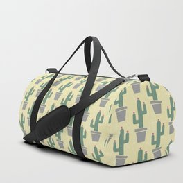 Solitary cactus on a yellow wall Duffle Bag