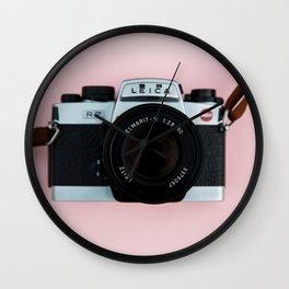 Camera on Blush Pink Background Wall Clock