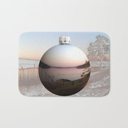 Holiday bauble with summer vs. winter nature scene Bath Mat