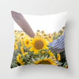 Couple holding hands in a sunflower field Throw Pillow