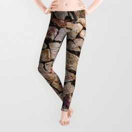 Traditional walls made of piles of broken stones. Antique stonewall. Leggings
