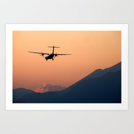 Airplane landing at sunset on the summer solstice Art Print