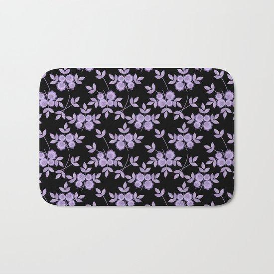 Retro . purple flowers on a black background . Bath Mat
