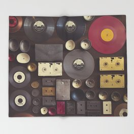 Music. Vintage wall with vinyl records and audio cassettes hung. Throw Blanket