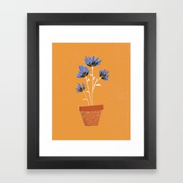 blue flowers on orange background Framed Art Print
