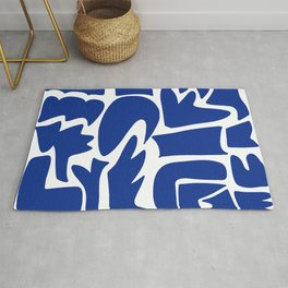 Blue shapes on white background Rug