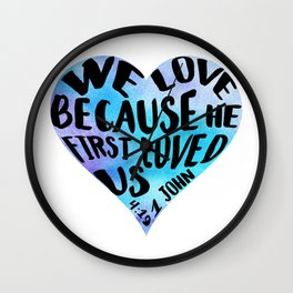 1 John 4:19 We love because He first loved us blue watercolor Bible verse Heart shape Wall Clock