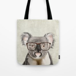 A baby koala with glasses on a rustic background Tote Bag
