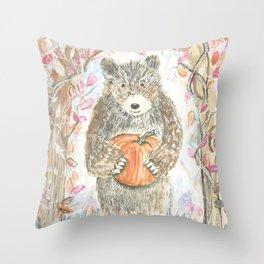 A bear bearing a pumpkin Throw Pillow
