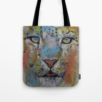 snow leopard Tote Bags featuring Leopard by Michael Creese