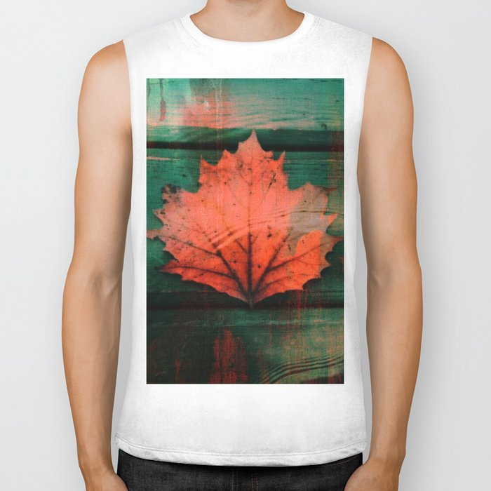 Rusty red dried fall leaf on wooden hunter green beams Biker Tank